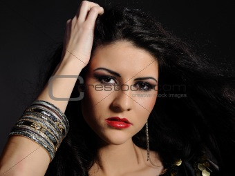 Beautiful woman portrait with bright make-up and long black hair