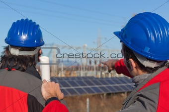 Engineers at Work In a Solar Power Station