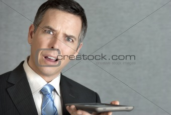 Businessman Perplexed By Tablet