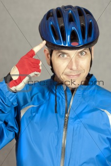 Cyclist Points To His Helmet