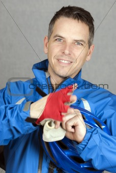 Cyclist Puts On His Gloves