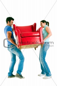Couple carrying a chair