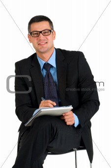 sitting businessman with eyeglasses writing