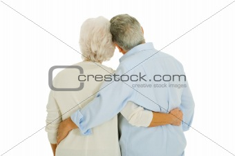 happy elderly couple embraced from behind