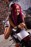 Attractive tattooed girl sitting on a big chopper