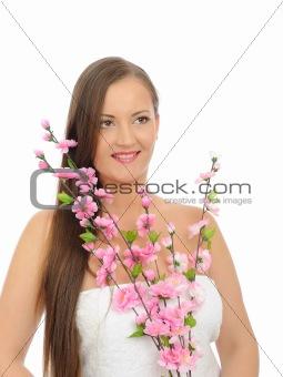 Beautiful woman in bath towel with long healthy hair
