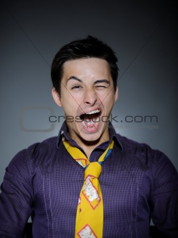 Expressions Handsome man in funny shirt and tie laughing
