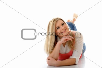 young casual smiling woman lying on the floor isolated on white