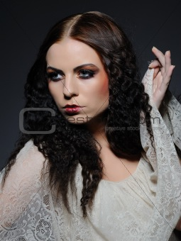 Gothic female portrait with creative make-up and white pure skin