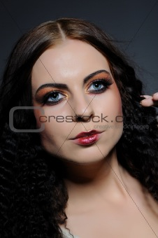 Beauty portrait of woman face with creative fashion make-up
