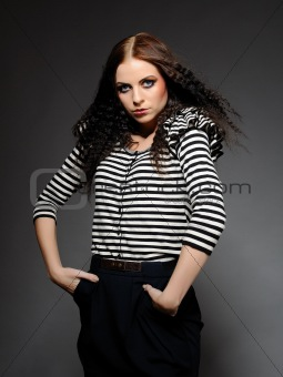 Beautiful fashion woman in stripy top with creative make-up