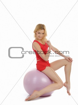Pretty sporty fitness woman doing exercise with pilates ball.