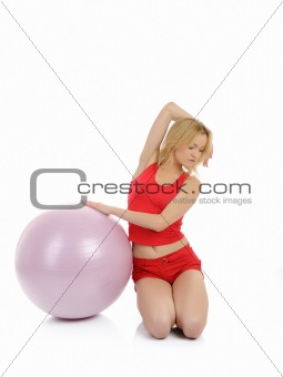 Beautiful fitness woman doing exercise with pilates ball.