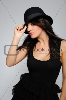 Beautiful sexy woman with slim body in elegant dress and hat