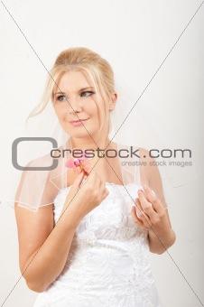 beautiful bride in white wedding dress smiling