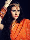 Young beautiful woman in indian traditional sari dress