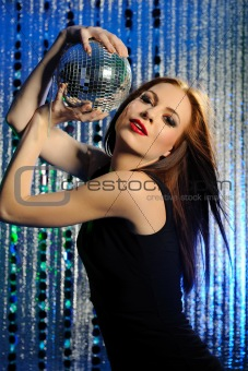Attractive sexy woman clubbing, dancing in the disco and moving