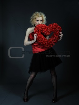 Pretty seductive woman with red heart