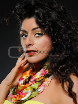 Beautiful woman with fashion make-up. black background