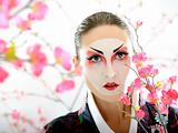Artistic portrait of japan geisha woman with creative make-up