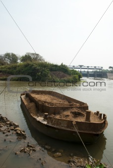 old boat on a river in forest