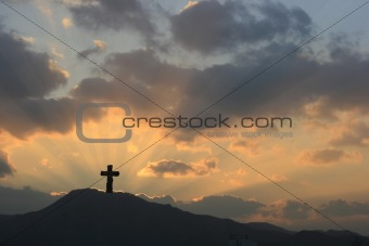 Cross on Dramatic Sunset
