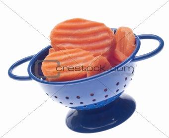 Carrot Slices in Blue Colander