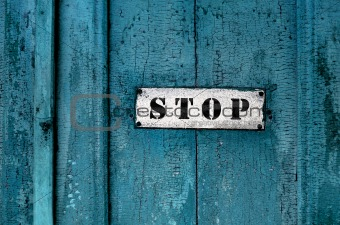 a sign saying ''stop''on the grunge wooden background