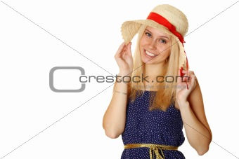 Beautiful young blond woman in a straw hat