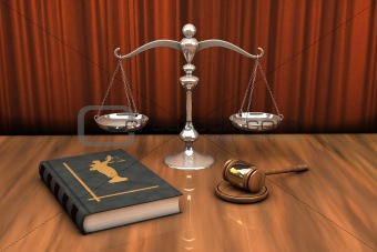 Gavel, scale and law book on the table
