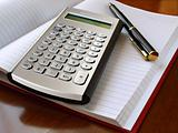planner with calculator and pen