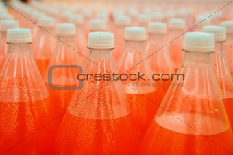 orange juice beverage plastic bottle in factory