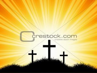 Crosses against sunset sky
