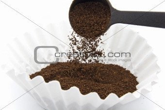 Pouring ground coffee