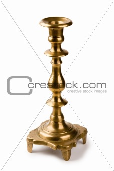 Ancient fine-molded brass candlestick for one candle isolated on a white background