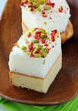 piece of cake with marshmallows and pistachios