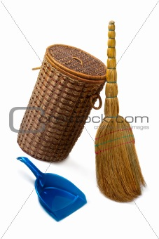 Basket  for garbage,  broom and a dustpan.