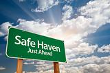 Safe Haven Green Road Sign with Dramatic Clouds, Sun Rays and Sky.