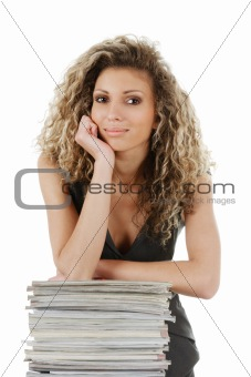 Woman with stack of magazines