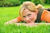 Young woman relaxing on the grass