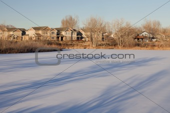 houses and frozen lake in Colorado