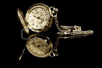 old pocket watch with reflection