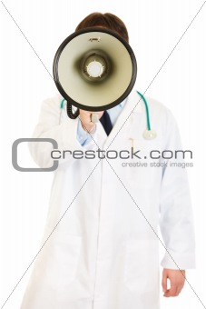 Doctor standing in front of camera and speaking into megaphone