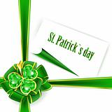 St.Patrick holiday bow with emerald shamrock