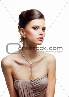 beauty portrait of a young woman in an evening outfit