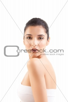 a beauty image of a young woman looking over her shoulder.