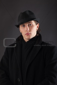 Man in black cloth and hat