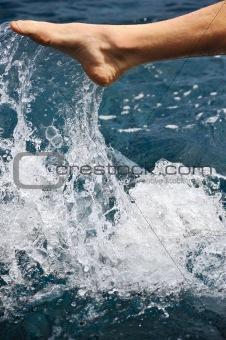Foot of young man in water - splash