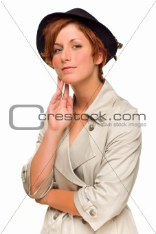 Attractive Red Haired Girl Wearing a Trenchcoat and Hat Isolated on a White Background.