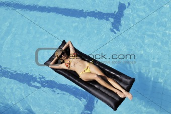 beautiful woman relax on swimming pool